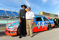 Nov. 20, 2009; Homestead, FL, USA; NASCAR Sprint Cup Series team owner Richard Petty (left) poses for a photo with Edsel Ford II during qualifying for the Ford 400 at Homestead Miami Speedway. Mandatory Credit: Mark J. Rebilas-