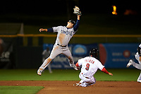 Peoria Javelinas second baseman Luis Urias (9), of the San Diego Padres organization, attempts to apply a tag to Blake Trahan (9) after jumping to catch a throw during an Arizona Fall League game against the Scottsdale Scorpions on October 20, 2017 at Scottsdale Stadium in Scottsdale, Arizona. the Javelinas defeated the Scorpions 2-0. (Zachary Lucy/Four Seam Images)