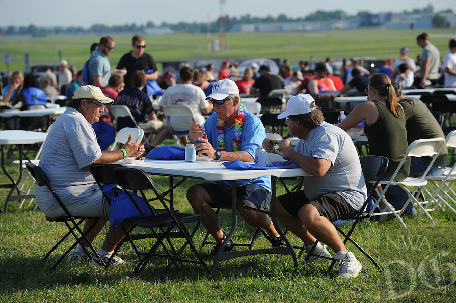 NWA Democrat-Gazette/ANDY SHUPE<br /> A large crowd fills the tables and chairs to eat Saturday, June 11, 2016, during the 12th annual Wingfest at Parsons Arena in Springdale. The fundraising event features chicken wing competition between 11 area merchants, music and games to benefit the Springdale Kiwanis Club and Kendrick Fincher Hydration for Life.