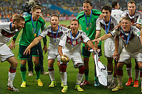 Mario Gotze of Germany lifts the World Cup trophy after winning the 2014 final celebrating with his team mates