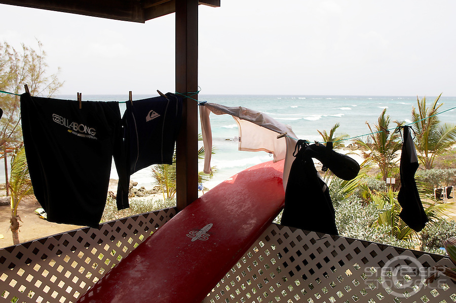 Rash vests and board  , Surfers Point ..Barbados , Easter 2010 ..pic copyright Steve Behr / Stockfile