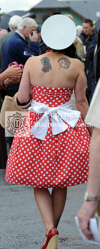 KILLARNEY RACES THURSDAY 16-7-09:Cathy Troth from Firies, Kilalrney was radiant in red at the Dawn Dairies Queen of Fashion at Killarney races on Thursday.<br /> Picture by Don MacMonagle