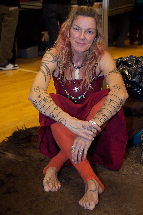 Tattoo Convention in Kolding 2011. Arranged by BodyMod.dk<br /> Young woman with extensive tattoes on both arms.