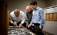 Norwegian employees of the European company StatOil, Lars Erik Oino (cq,44, left), a geologist from Oslo, Thomas Johansen (cq, 32, middle), a completion engineer from Matrand, and Eivind Vamraak (cq, 37) a mid steam engineer, from Stavanger, interpret shale ore samples at Chesapeake Energy's headquarters in Oklahoma City, OK, Thursday, Sept., 23, 2009. Chesapeake Energy has a new program to work with foreign companies to help train on new shale technology...PHOTOS/ MATT NAGER