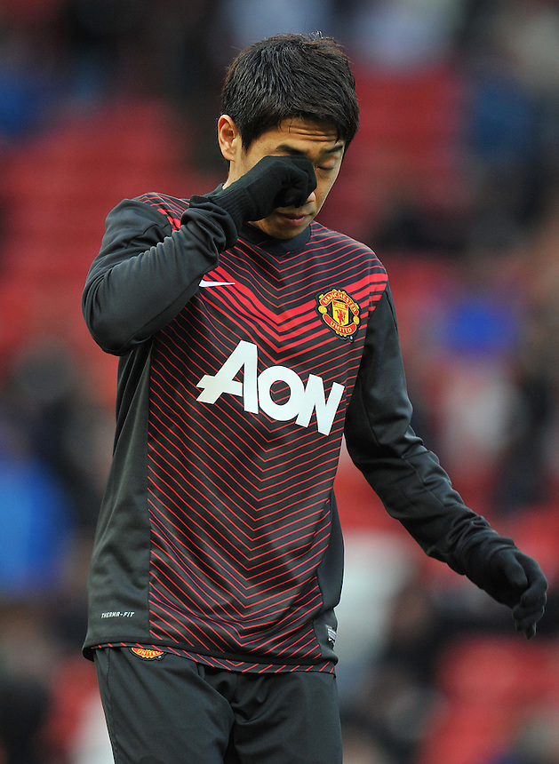 Manchester United's Shinji Kagawa during the pre-match warm-up <br /> <br /> Photo by Dave Howarth/CameraSport<br /> <br /> Football - Barclays Premiership - Manchester United v Fulham - Sunday 9th February 2014 - Old Trafford - Manchester<br /> <br /> &copy; CameraSport - 43 Linden Ave. Countesthorpe. Leicester. England. LE8 5PG - Tel: +44 (0) 116 277 4147 - admin@camerasport.com - www.camerasport.com