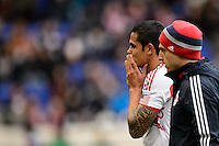 Tim Cahill (17) of the New York Red Bulls holds his hands to his face as he walks to the locker room with an injury during the first half against Chivas USA during a Major League Soccer (MLS) match at Red Bull Arena in Harrison, NJ, on March 30, 2014.