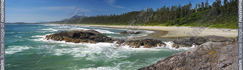 Green Point beach at Pacific Rim National Park Reserve, Long Beach, panoramic scenery in bright summer sunshine with people in the background. Pacific ocean shore at Tofino, Vancouver Island, BC, Canada Image © MaximImages, License at https://www.maximimages.com