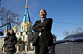 He Wenan, one of the most successfu Chinese enterpreneurs in the Russian Far East, poses for a portrait in city of Blagoveshchensk with his Bentley. In the back is a passerby and a Russian Orthodox church.