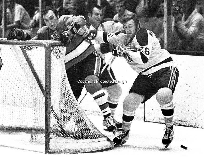 Seals vs Pittsburg: Seals Gerry Ehman, and #26 Tommy Williams, Penguin #6 Dunc McCallum.  (1971 photo/Ron Riesterer)