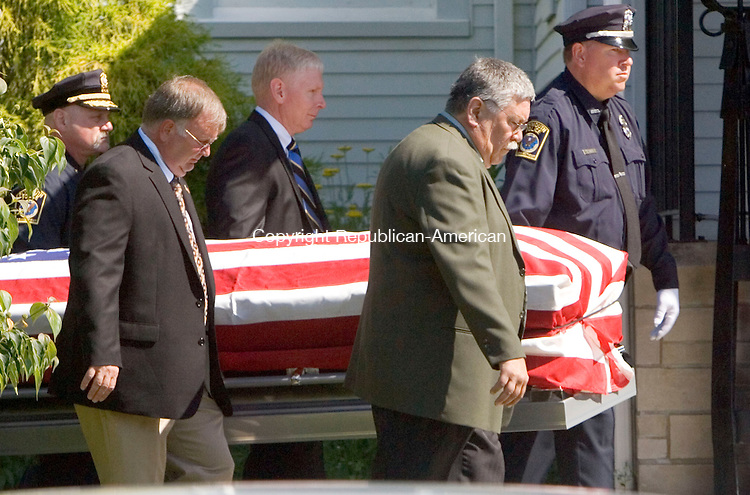 PLYMOUTH CT. 08 July 2013-070813SV02-The casket of former Plymouth Police Chief Clement Paskus enters Immaculate Conception Catholic Church in Plymouth Monday. Paskus died Tuesday July 2 after a long illness. Paskus served the town for 31 years as a police officer then chief. He was also involved in the Terryville Volunteer Fire Department years ago. <br /> Steven Valenti Republican-American