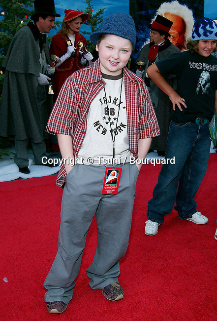 Spencer Breslin  arriving at the Santa Clause 2 premiere at the El Captain Theatre in Los Angeles. October 27, 2002.