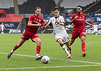 Swansea City's Liam Cullen (centre) battles with Bristol City's Tomas Kalas (left) and Zak Vyner (right) <br /> <br /> Swansea City's Liam Cullen (centre) battles with  Bristol City's Tomas Kalas (left) and Zak Vyner (right) <br /> <br /> Photographer David Horton/CameraSport<br /> <br /> The EFL Sky Bet Championship - Swansea City v Bristol City- Saturday 18th July 2020 - Liberty Stadium - Swansea<br /> <br /> World Copyright © 2019 CameraSport. All rights reserved. 43 Linden Ave. Countesthorpe. Leicester. England. LE8 5PG - Tel: +44 (0) 116 277 4147 - admin@camerasport.com - www.camerasport.com