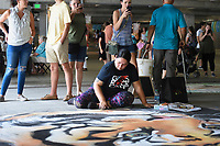 NWA Democrat-Gazette/CHARLIE KAIJO Artist Fawne DeRosia (center) finishes an art piece during the first annual chalk festival, Sunday, August 10, 2019 at Crystal Bridges in Bentonville.<br /> <br /> 23 professional chalk artists turned concrete into masterpieces at Crystal Bridges. The artists finished their pieces on Sunday with some 4,000 visitors attending the two-day event. Attendees also enjoyed live music, food trucks and a kids chalking area.