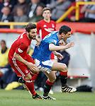 08.05.2018 Aberdeen v Rangers: Graham Dorrans feels the force of Graeme Shinnie