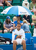 June 15th 2017, Nottingham, England; ATP Aegon Nottingham Open Tennis Tournament day 6;  Early rain break and Marius Copil of Roumania looks cold as he waits for the restart against Reilly Opelka of USA