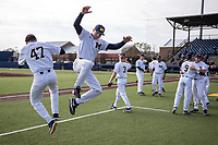 Michigan Wolverines pitchers Tommy Henry (47) and Jeff Criswell (17) pregame routine before the NCAA baseball game against the Eastern Michigan Eagles on May 8, 2019 at Ray Fisher Stadium in Ann Arbor, Michigan. Michigan defeated Eastern Michigan 10-1. (Andrew Woolley/Four Seam Images)