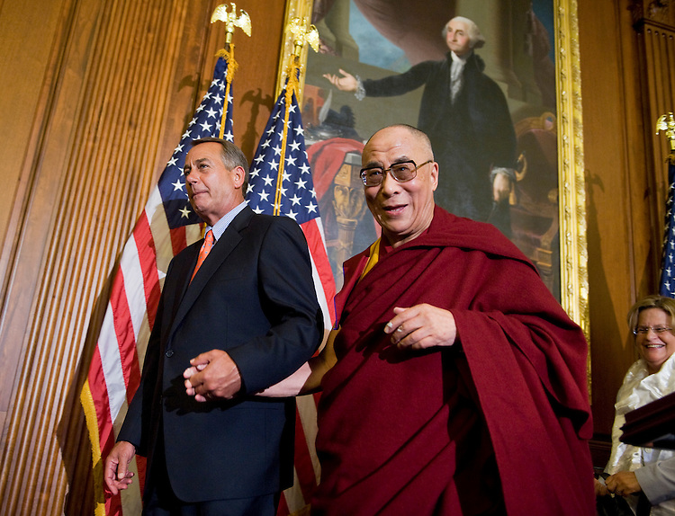 "UNITED STATES - JULY 07:  The Dalai Lama of Tibet, Tenzin Gyatso, leaves a news conference in the Capitol's Rayburn Room with Speaker John Boehner, R-Ohio, after a meeting with House Minority Leader Nancy Pelosi, D-Calif., and other members of Congress.  Boehner remarked they discussed the Dalai Lama's shared values with the United States including ""freedom, tolerance and respect for human dignity.""  (Photo By Tom Williams/Roll Call)"