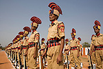 "DANTEWARA, CHHATTISGARH, INDIA, FEBRUARY 27, 2008 : Graduation ceremony for the graduation of the new recruits of the 9th Battallion of Chattisgarh Armed Police with the visit of Chhattisgarh's Home Minister Ram Vichar Netam and police officials, including Dantewara Superintendant of Police, Rahul Sharma (uniform no mustache). The Maoist insurgency called Naxalites have been waging a war against the government for the past 25 years and has been gaining momentum in in the past few years. They are present in some 150 of the 600 districts of India, and Dantewara is one of Chhattisgarh rural Maoist stronghold where they control most of the countryside. The overwhelmed police force is hiring more personel to deal with the Naxalite threat and the Government has armed civil defence anti-naxalite milicias to take on the naxalites , emptying villages to cut local support to the rebels. The movement called ""Salwa Judum"" (campaign for peace in the  started in june 2005 when some villages took a stand against the Maoists, but it is dragging the whole district into the bloody civil war, at the expense of the  local tribal villagers caught in the middle, making it the deadliest theater of the war. The conflict has claimed over 900 lives in 2006 and again in 2007, and some 50 to 60,000 people live in makeshift camps, displaced from their ancestral villages. (Photo by Jean-Marc Giboux/GettyImages)"