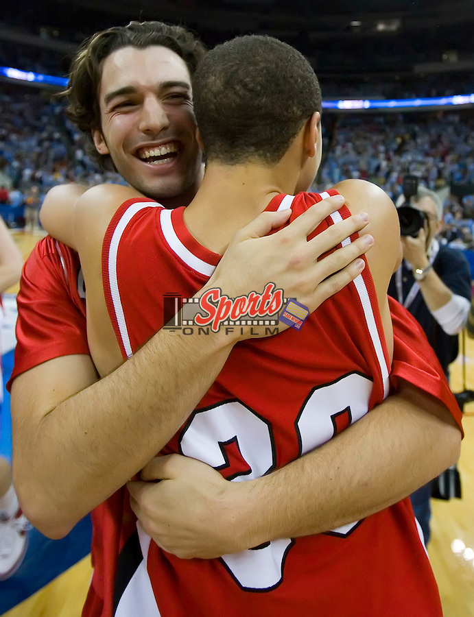 William Archambault (22) of the Davidson Wildcats celebrates with teammate Stephen Curry (30) following their 74-70 upset of the Georgetown Hoyas in second round action of the 2008 NCAA Men's Basketball Championship at the RBC Center in Raleigh, NC, Sunday, March 23, 2008.
