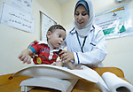 Nurse Leila Elamoudi weighs 10-month old Malek in a clinic in Gaza City supported by DanChurchAid, a member of the ACT Alliance, whose members are supporting health care, vocational training, rehabilitation of housing and water systems, psycho-social care, and other humanitarian actions throughout the besieged territory.<br /> <br /> Parental consent obtained.