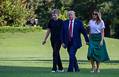 Barron Trump, United States President Donald J. Trump and First Lady Melania Trump return to the White House following a stay in Bedminster, New Jersey in Washington, D.C. on August 18, 2019. <br /> Credit: Tasos Katopodis / Pool via CNP