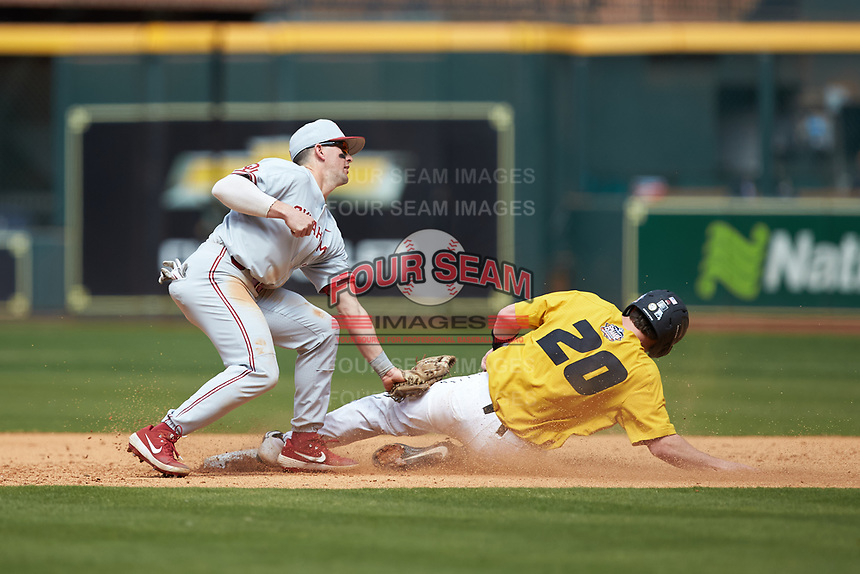 Conor McKenna (5) of the Oklahoma Sooners applies a tag to Chad McDaniel (20) of the Missouri Tigers as he slides into second base in game four of the 2020 Shriners Hospitals for Children College Classic at Minute Maid Park on February 29, 2020 in Houston, Texas. The Tigers defeated the Sooners 8-7. (Brian Westerholt/Four Seam Images)