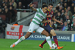 11.12.2013 Barcelona, Spain. UEFA Champions League, Group H Matchday 6. Picture show  Efe Ambrose (L) and Cristian Tello (R)  in action during game between FC Barcelona Against Celtic at Camp Nou