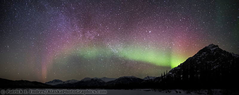 The northern lights and the milky way galaxy over the Brooks Range, Arctic, Alaska.