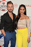 LOS ANGELES - JUL 24:  Artem Chigvintsev, Nikki Bella at the 9th Annual Variety Charity Poker & Casino Night at the Paramount Studios on July 24, 2019 in Los Angeles, CA