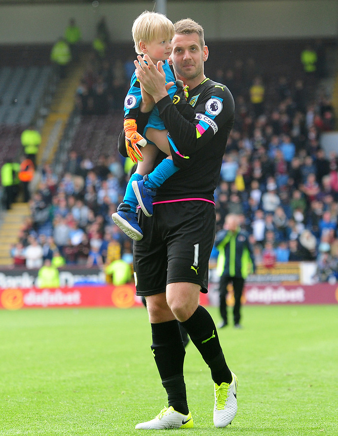 Burnley's Thomas Heaton applauds the fans at the end of the game, with his young child in arms<br /> <br /> Photographer Andrew Vaughan/CameraSport<br /> <br /> The Premier League - Burnley v West Ham United - Sunday 21st May 2017 - Turf Moor - Burnley<br /> <br /> World Copyright &copy; 2017 CameraSport. All rights reserved. 43 Linden Ave. Countesthorpe. Leicester. England. LE8 5PG - Tel: +44 (0) 116 277 4147 - admin@camerasport.com - www.camerasport.com