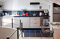 All mod cons are included in this compact kitchen built under the eaves of a Paris town house