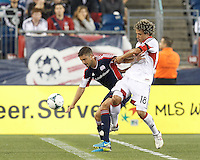 New England Revolution defender Chris Tierney (8) controls the ball as D.C. United midfielder Nick DeLeon (18) pressures. In a Major League Soccer (MLS) match, the New England Revolution (blue) defeated D.C. United (white), 2-1, at Gillette Stadium on September 21, 2013.