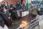 "© Joel Goodman - 07973 332324 - all rights reserved . 11/11/2010 . London , UK . MOHAMMED REZA HAQUE (aka "" Giant "") (centre) . Muslims Against Crusades hold a demonstration and burn a poppy on the anniversary of Armistice Day , at Kensington Gore , opposed by a demonstration of nationalist groups including the English Defence League ( EDL ) . Photo credit : Joel Goodman"