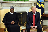 United States President Donald Trump meets with President Muhammadu Buhari of Nigeria in the Oval Office of the White House on April 30, 2018 in Washington, DC. <br /> Credit: Olivier Douliery / Pool via CNP /MediaPunch