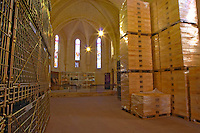 A unique winery wine bottle storage room in an old disaffected church in the village Potensac with stained glass windows  Chateau Potensac Cru Bourgeois Ordonnac  Medoc  Bordeaux Gironde Aquitaine France