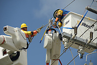 Lineman Titus Beauman, left, of Pike repairs a damaged feeder line as Chris Montiel, right, helps in South Miami-Dade county after Hurricane Irma Sept 11, 2017.  (Photo by David Adame/For FPL)
