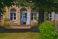 The chateau garden with metal garden furniture a sunny summer day Chateau de Haux Premieres Cotes de Bordeaux Entre-deux-Mers Bordeaux Gironde Aquitaine France