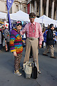 A woman and a man in colourful costume attend the 10th Japanese Matsuri Festival, Trafalgar Square, London.