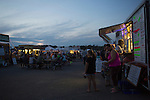 Attendees of the Pawpaw Festival wait to get food at the lines of food trucks and vendors during the festival on Sept. 16, 2016.