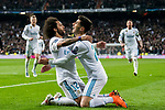 Marcelo Vieira Da Silva of Real Madrid celebrates with teammate Marco Asensio Willemsen during the UEFA Champions League 2017-18 Round of 16 (1st leg) match between Real Madrid vs Paris Saint Germain at Estadio Santiago Bernabeu on February 14 2018 in Madrid, Spain. Photo by Diego Souto / Power Sport Images