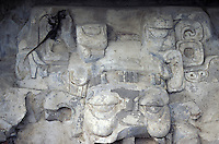 Stucco mask of the Sun God, Temple of the Mask, at the Mayan ruins of Comalcalco, Tabasco, Mexico. Colmalcalo is unusual because many of its structures are made of kilned bricks.