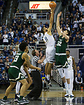 Nevada's Cody Martin outjumps Colorado State's Nico Carvacho for the tip-off during an NCAA college basketball game in Reno, Nev., Sunday, Feb. 25, 2018. (AP Photo/Tom R. Smedes)