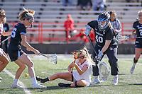 College Park, MD - April 27, 2019: John Hopkins Bluejays goalie Haley Crosson (40) knocks down Maryland Terrapins attack Caroline Steele (11) during the game between John Hopkins and Maryland at  Capital One Field at Maryland Stadium in College Park, MD.  (Photo by Elliott Brown/Media Images International)