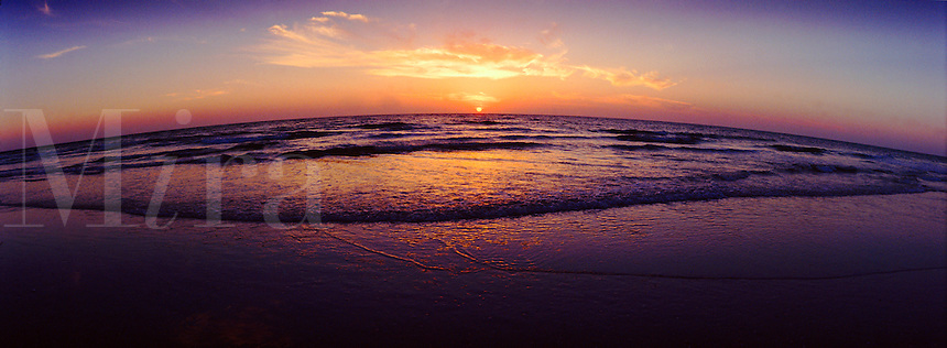 Panoramic beach at sunset.