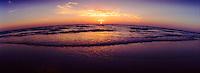 Panoramic beach at sunset.