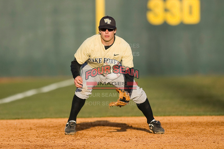Third baseman Taylor Kaprive #5 of the Wake Forest Demon Deacons on defense against the Virginia Tech Hokies at English Field March 27, 2010, in Blacksburg, Virginia.  Photo by Brian Westerholt / Four Seam Images