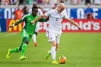June 07, 2014:   the United States of America midfielder Michael Bradley (4) controls the ball downfield during first half action between the USA Men's National Soccer team and Nigeria at EverBank Field in Jacksonville, Florida.  This is the last match before the USA team leaves for Brazil and the 2014 World Cup Championships.   The USA Men's Team defeated Nigeria 2-1.