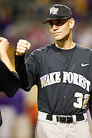Wake Forest Demon Deacons head coach Tom Walter #32 during player introductions prior to the game against the LSU Tigers at Alex Box Stadium on February 18, 2011 in Baton Rouge, Louisiana.  The Tigers defeated the Demon Deacons 15-4.  Photo by Brian Westerholt / Four Seam Images