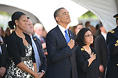 President Barack Obama and First Lady Michelle Obama stand with Irene Hirano Inouye, right, wife of the late U.S. Senator Daniel Inouye (Democrat of Hawaii) as taps is played by a bugler near the casket of the late Senator Inouye at the National Memorial Cemetery of the Pacific during ceremonies on Sunday, December 23, 2012. Senator Inouye was a Medal of Honor recipient and a United States Senator since 1963.    .Credit: Cory Lum / Pool via CNP