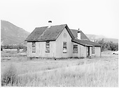 Rear view of D&amp;RGW Poncha Junction section house, all boarded up.<br /> D&amp;RGW  Poncha Junction, CO  Taken by Graves, William A. - 1958